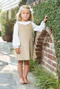 Our classic shift is sure to be a staple in your little girl's wardrobe this season!  A khaki, whale corduroy fabric with our whimsical logo embroidered on the hem.  Pair with our Vintage Collar Shirt to complete this look.  Perfect for school uniform requirements too!   Matching outfits available to coordinate the perfect occasion! Delivery Time: …