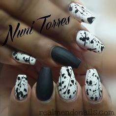 Mat nails with splash of black polish on white nails. By nunis Torres