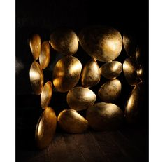 Gold is a golden folding screen; this luxury gold leaf piece offers a sculptural composition that works as room divider.