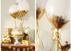 Witte ballonnen bewerkt met gouden verf