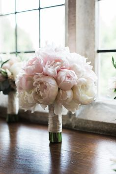 Pure and elegant bridal bouquet of blush pink peonies