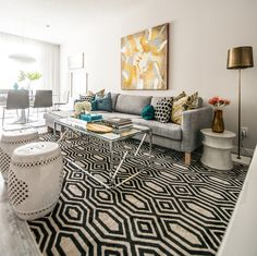Hesitant to combine printed throw pillows in the living room? Don't be! Take a look at these spaces.