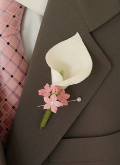possibly substitute small purple flowers for the pink and a green leaf behind the lilly ...or wrap in purple ribbon