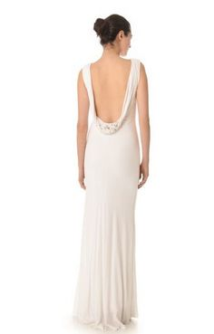 This slinky jersey gown is perfect for a bride who wants a simplistic look. Just a hint of mixed crystals on the deep cowl back takes this gown from plain to perfect; $595.00, available at shopbop.com.