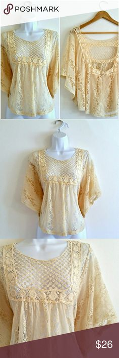 """(399) Lace and Crochet Open Back Boho Top - Size M This top is so cute. Lace & crochet see-through, with daisy / floral details. Super lightweight and so boho; festival fashion at its finest with a vintage, retro flair. Fluttery shawl shape with open sleeves. Amazing sexy peekaboo open back. Beautiful creamy color. Absolutely adorable.   Bust - 40"""" Waist - 43"""" Length - 23"""" Size - estimated medium (PLEASE CHECK MEASUREMENTS) Label - Vivid Importers of NY  Color may vary slightly based on…"""