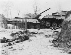 November 1941: Near Moscow, two wrecked Russian tanks and the frozen bodies of fallen Red Army soldiers