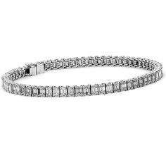 This diamond bracelet showcases sixty-nine emerald-cut diamonds that are expertly matched and intricately set in platinum. (7.50 ct tw)