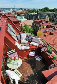 This unique balcony from freshome uses the form of the roof for additional seating - how cool is that? The mint green table and chairs with the rusty red roof makes for a great combo.