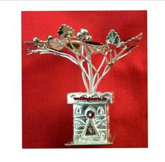 Silver Tulsi kundi.Best for puja purpose and gifting for housewarming ceremony/ special occasions.Price :1500Rs.