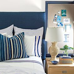 Kids' Bedrooms: Boy's Room | In the boy's room, interior designer Suzanne Kasler took a slightly nautical direction that is particularly apropos for a home on the water. She anchored the room with a navy headboard and bed skirt. Then, she layered on striped navy-and-white bedding.