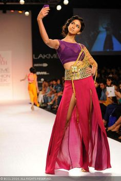 A model walks the ramp for designer Shubhika on Day 5 of the Lakme Fashion Week (LFW) Summer Resort 2014, held at Grand Hyatt, Mumbai, on March 15, 2014.