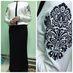 Muslima Wear White Jacket with black embroidery on sleeves.