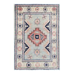 With a distinctive style, a gorgeous area rug from Afghanistan will add some splendor to any decor. This Kazak area rug is hand-knotted with a geometric pattern in shades ofgray, rust, navy, pink, and light blue.