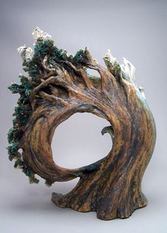 I like this clay sculpture because it shows movement and it is decorated almost  like a real tree.   it has many colors which makes it creative and easier to see