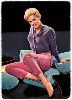 | Kim Novak | German postcard by Krüger, no. 902/29.  American film and television actress Kim Novak (1933) starred in such popular successes as Picnic (1955), The Man with the Golden Arm (1955) and Pal Joey (1957). However, she is perhaps best known today for her 'dual role' as both Judy Barton and Madeleine Elster in Alfred Hitchcock's classic thriller Vertigo (1958). She withdrew from acting in 1966, and has only sporadically returned since.  Kim Novak was born as...