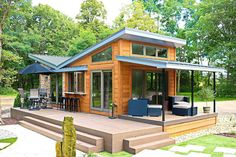 This is the Valley Forge Park Model Tiny House by Utopian Villas out of Oak Creek, Wisconsin. It's a 400 sq. modern cabin on wheels with a large front porch and additional but optional de… Tiny House Exterior, Tiny House Builders, Free House Plans, Small House Plans, Small Room Design, Tiny House Design, Tyni House, Prefab Cabins, Prefab Tiny Houses