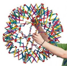 How to teach children deep breathing exercises using a Hoberman sphere as a visual of breathing in and out.