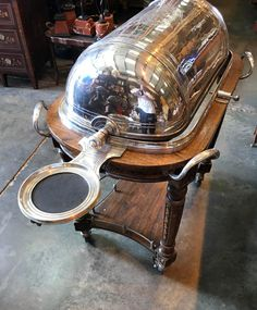 - Stunning antique Maison Christofle silver plate beef trolley<BR> - Piece features two gravy boats<BR> - We date this piece to circa 1930<BR> - Intricately hand carved wooden base in walnut, just look at the intricately carved details<BR> - It has 2 burners <BR> - The dome is engraved <BR> - This was purchased from a Paris hotel/ restaurant <BR> - It does have an engraved Christofle plate <BR> - The trolley will be fully restored and repla... Gravy Boats, Architectural Antiques, Paris Hotels, French Antiques, Hand Carved, Silver Plate, Restoration, Carving, Base