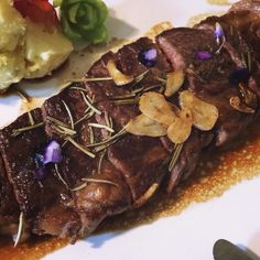 steak, purple edible flower, salt, garlic, rosemary