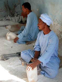 Two workers making the jars outside the Alabaster Factory . Valley of the Kings, Egypt