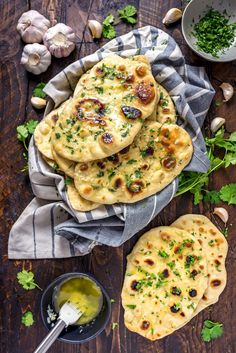 Homemade Garlic Naan on top of a blue and white striped towel that rests on a wooden table. Indian Food Recipes, Vegetarian Recipes, Cooking Recipes, Recipes With Naan Bread, Flatbread Recipes, Naan Recipe, Garlic Naan Bread Recipe, Fried Fish Recipes, Indian Dishes