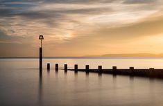 Landscape-England-Beach-ocean-groyne-wooden-structure-long-exposure-sunset - AntonyZ Photography