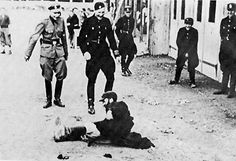 http://www.zwoje-scrolls.com/shoah/poland.html German soldiers kicking a Jew, Wloclawek, German occupied Poland, 1939