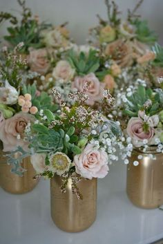 This is such a great beach wedding DIY idea! Spray paint mason jars with gold paint and fill each one with pink roses and succulents! I love this unique wedding decoration idea - perfect for a gold and pink wedding.
