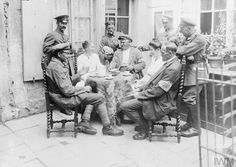 WWI, June 1917; German soldiers drinking coffee with their landlord in a French billet. ©IWM Q 70773