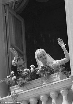 Following their church wedding on April 19, 1956,  Princess Grace and Prince Ranier wave from a palace window