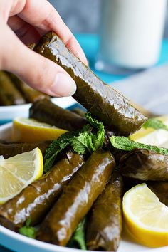 An easy recipe for dolma or stuffed grape leaves that's healthy and hearty. Check out the video and tutorial on how to make stuffed grape leaves. Lunch Recipes, Great Recipes, Dinner Recipes, Favorite Recipes, Delicious Recipes, Amazing Recipes, Stuffed Grape Leaves, Good Food, Cuisine