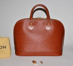 Louis Vuitton Epi Alma Pm Dust Lock Key Brown Satchel. Save 77% on the Louis…