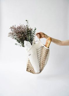 mesh shopping tote with lavender and bread. / sfgirlbybay