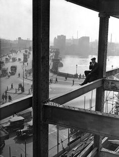 vintage everyday: A workman rests on a girder during the construction of Unilever House, London, 1931