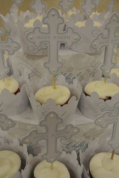 Baptism Cupcakes in a matching wrapper, matching pick and sitting on a matching cupcake stand, BEAUTIFUL!!!