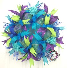 Peacock colored theme deco mesh wreath by www.southerncharmwreaths.com
