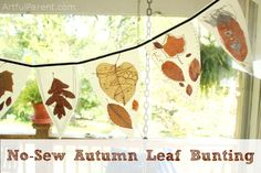 A tutorial to make a DIY autumn leaf bunting with leaves and wax paper. This no sew leaf bunting is fun to make and a great addition to fall decorations.