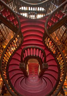 Livraria Lello in Porto, Portugal, with its dramatic red staircase, is known as one of the most beautiful bookstores in the world.