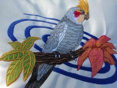 Cockatiel Tropical Sunbrella Embroidered Garden Pillow Natural. $48.00, via Etsy.