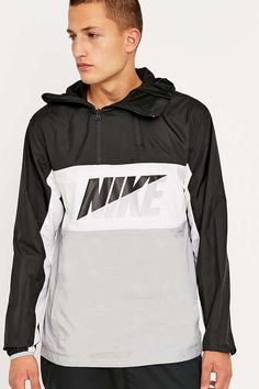 d2ef87190f Shop Nike Nylon Pullover Hoodie at Urban Outfitters today.