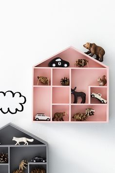 Decorate the kids room with house-shaped shelves.
