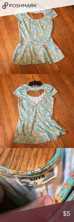 Floral peplum top Floral peplum top with a heart cut out on the back. Says size medium but fits more like a small. Has a little pit of piling to it but very cute and in good condition Tops