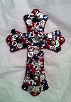 Painted wooden cross decorated with buttons and beads