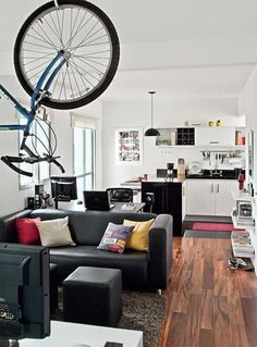 Great use of space, love the hanging bike.