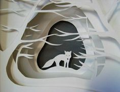 Paper cut out wolf in the woods