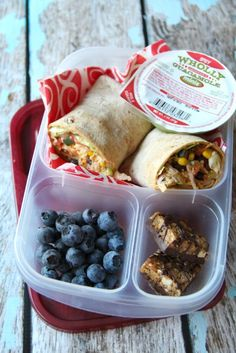 Mommy Lunch  A chicken wrap made with  Leftover Crockpot Cool Ranch Chicken, some Wholly Guacamole, blueberries and a Trader Joe*s Fiber bar.  Packed in EasyLunchboxes.