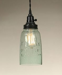 """Nothing says country like a good old fashioned Mason jar!Here's a lovely half gallon, open bottom pendant lamp made with an antique reproduction Mason jar.Measures 4½"""" diameter and 11¼"""" tall.Takes a 6"""