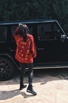 Kylie Jenner wearing Fan Merchandise Yeezy Season 3 Concert T-Shirt Long Sleeve I Feel Like Pablo, J Brand L8007 Leather Legging, Adidas Yeezy Boost 750 Season 2 Women
