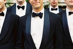 groomsemen and classic black and white tuxes with bowties