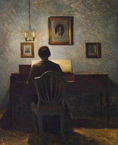 .:. Interior with a lady at a spinet, evening light, 1904, Peter Ilsted. Danish (1861 - 1933)